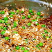 bulgur pilaf with feta, golden raisins and peas