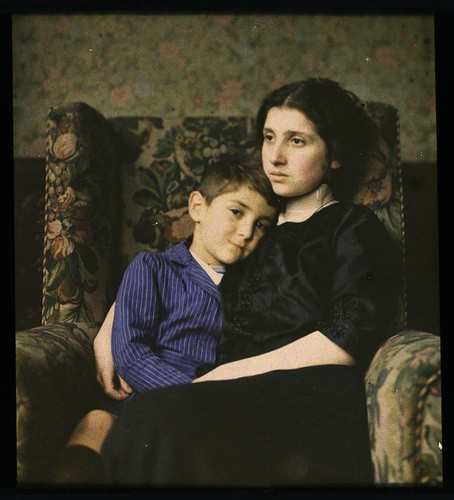 Woman and boy sitting in chair | by George Eastman House