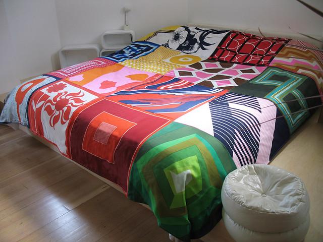 vintage scarf quilt on bed platform in the old altar by ouno design