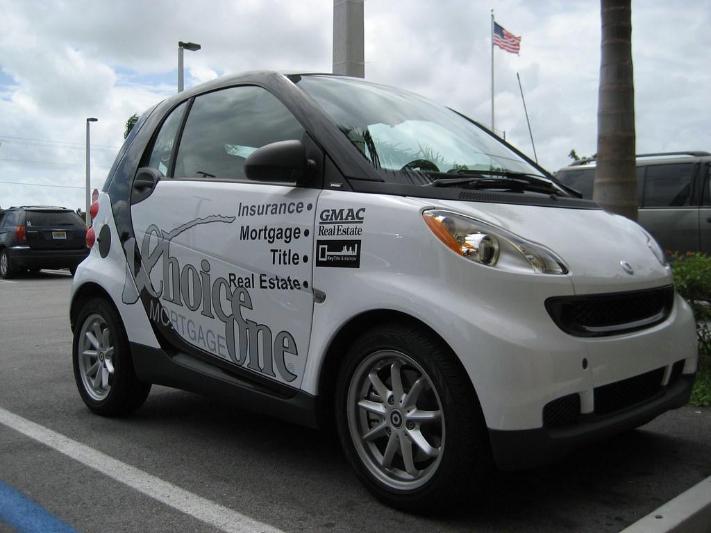white smart car black stripe 1 passenger side view