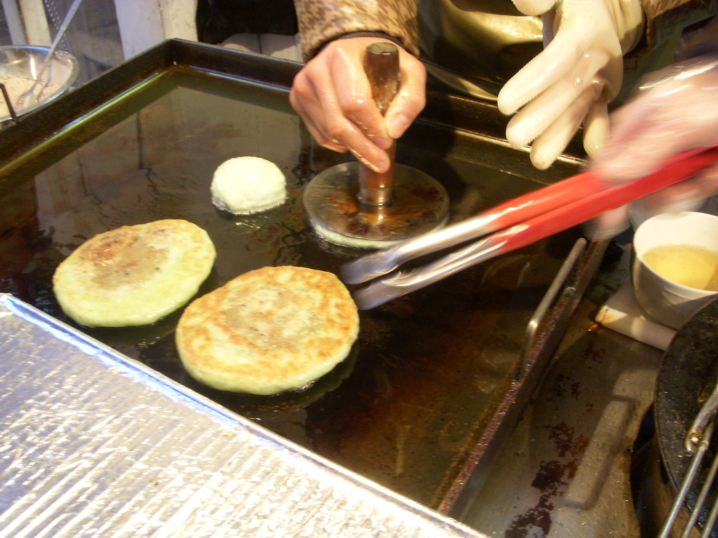 A street food worker making hotteok in South Korea