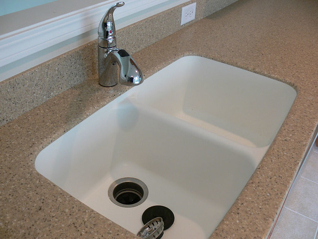 Corian countertop integrated seamlessly with the kitchen s - Corian bathroom sinks and countertops ...