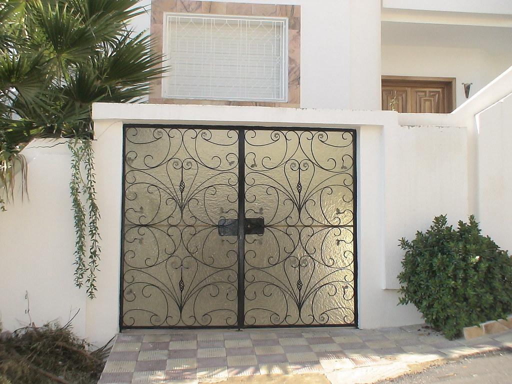 Style de porte exterieure en fer forg maisons de tunisie citizen59 flickr for Porte entree fer forge villa