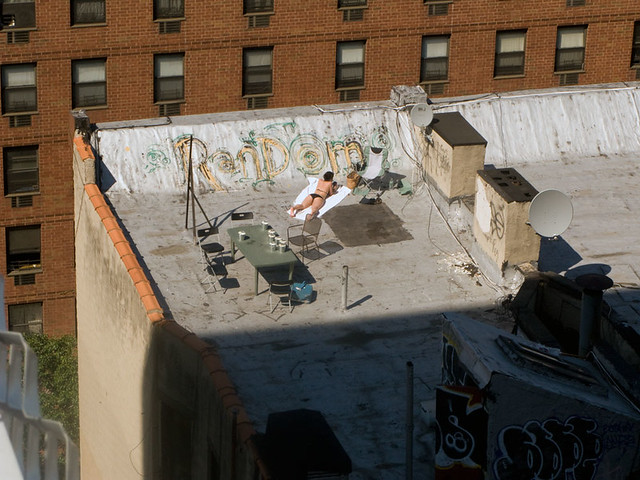 Woman Sunbathing On New York City Roof Top Woman