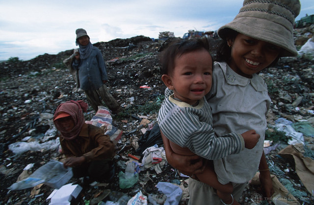 Collecting recyclable trash from a garbage dump   Children