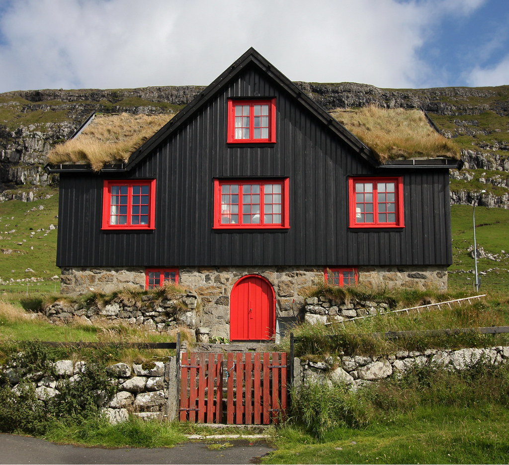 Black House Red Windows Grass Roof The Stereotypical