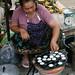 Cooking sweet rice cakes at the Phosy Market outside Luang Prabang, Laos