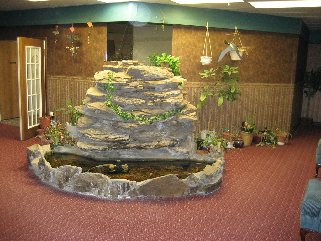 Motel indoor koi pond sadly the fountain wasn 39 t on when for Indoor koi fish pond