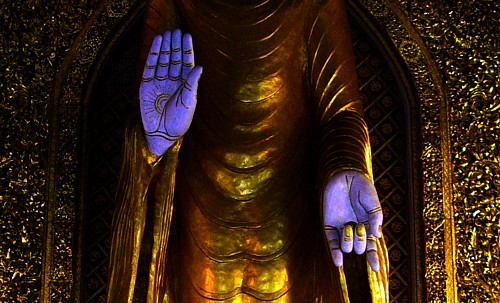 abhaya mudra left hand mudras of a buddha in one of temples in 10330