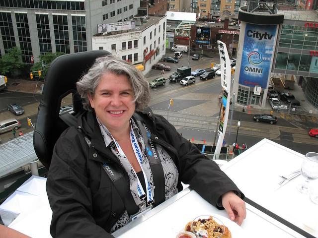 Alexa Clark above Yonge Dundas Square at Summerlicious Launch