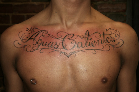 chest writing tattoos