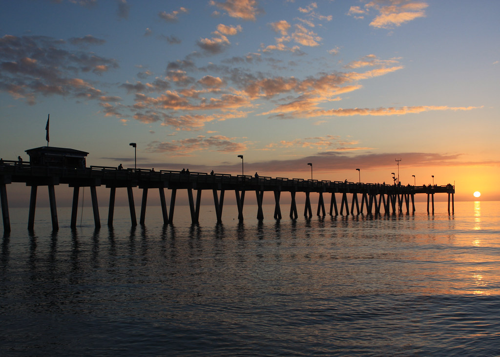 Sunset at fishing pier calm gulf of mexico during sunset for Gulf shores pier fishing forum