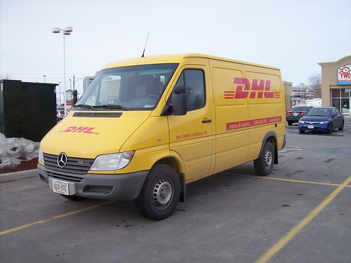 Courier Vans In The Parking Lot A Dhl Mercedes Sprinter