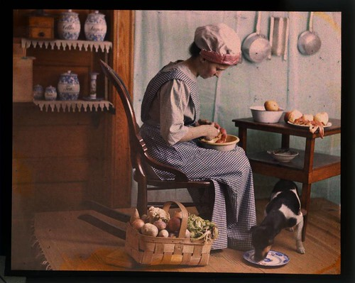 Genre scene, woman in kitchen peeling vegetables | by George Eastman House