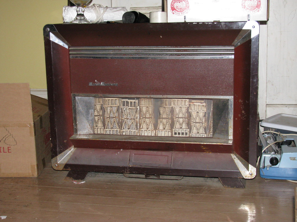 Vintage living room gas heater one in the kitchen one in flickr - Small room space heater decor ...