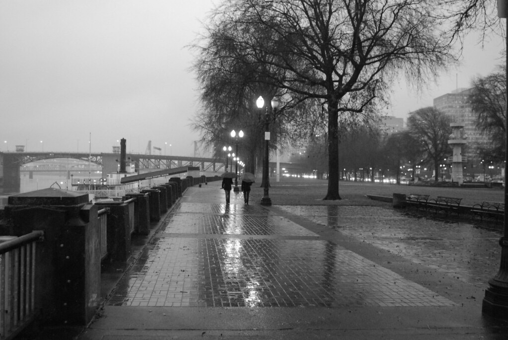 black and white version of two women walking in the rain a