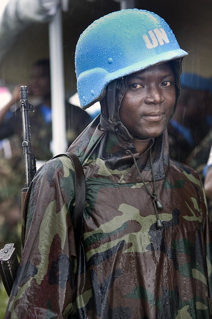 Female member of the Nigerian battalion of the United Nations Mission in Liberia stands in the rain.
