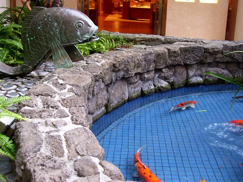 Metal sculpture with koi fish pond flickr photo sharing for Koi pond construction uk