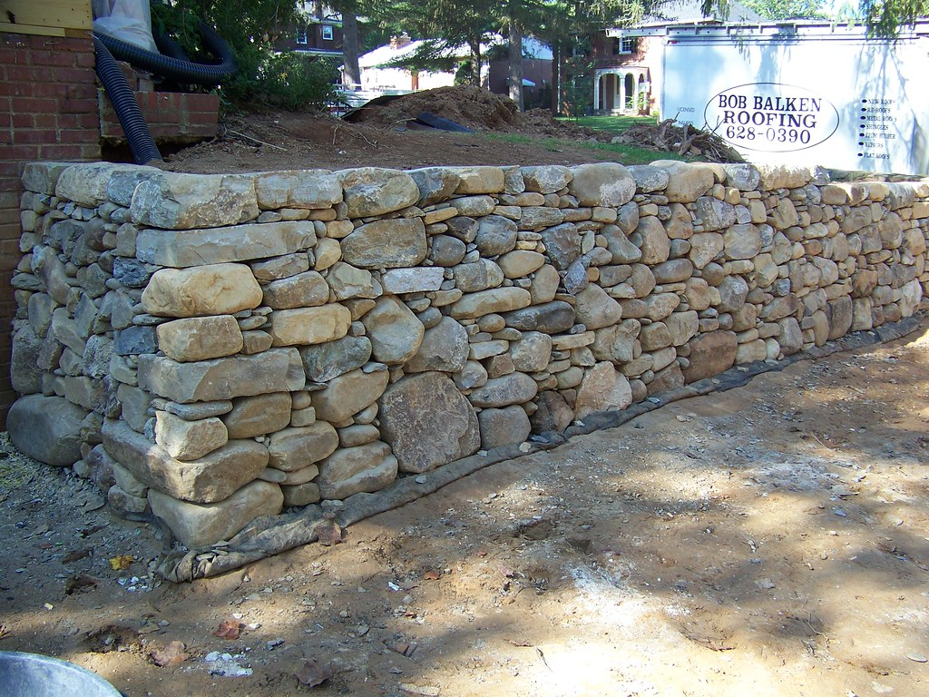 Dry laid retaining wall retaining wall using local river for River rock wall