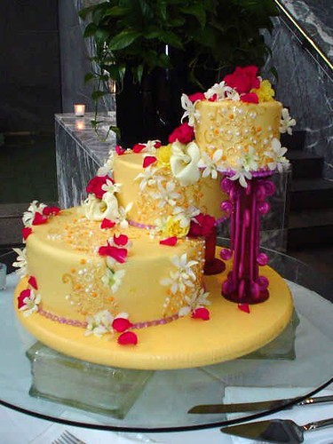 mango wedding cake mango wedding cake with handmade flowers and poured sugar 17107