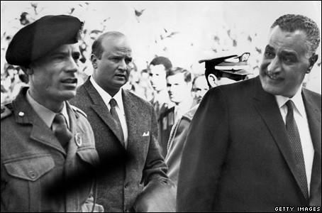 Col. Qaddafi after he seized power with the overthrow of the Monarchy in Libya in 1969. He is shown here with Egyptian leader Gamel Abdel Nassar. | by Pan-African News Wire File Photos