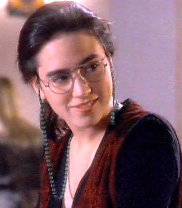 jennifer connelly wearing glasses attached to a beaded cha
