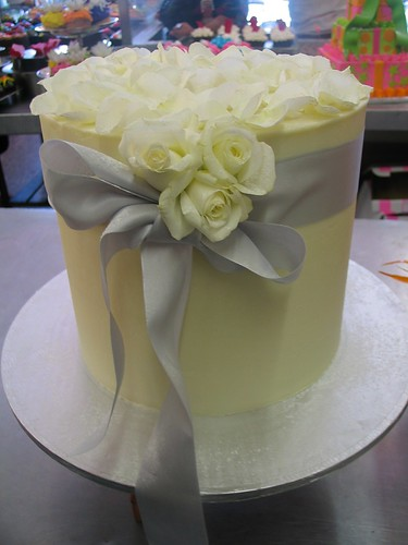 Tall Single Tier White Chocolate Ganache Wedding Cake With Silver Ribbon