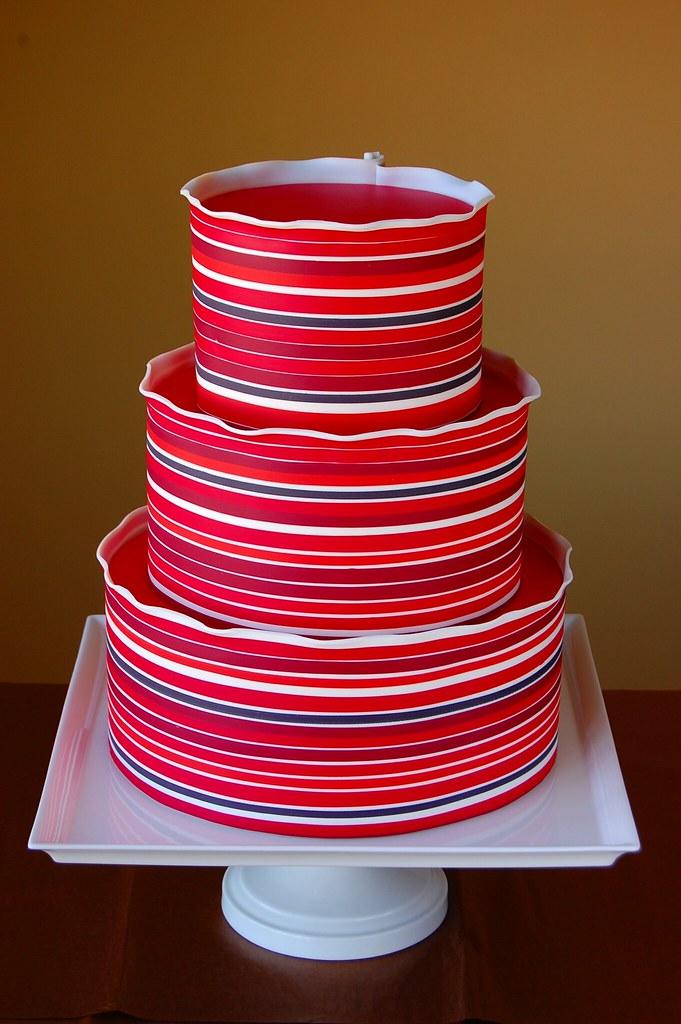 Cake Art Modeling Chocolate : Red Striped Cake Striped modeling chocolate wrapped ...