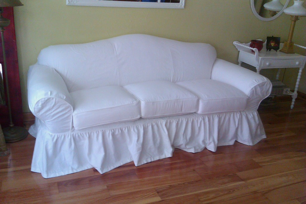 shabby chic slipcover a classic curvy sofa is given the. Black Bedroom Furniture Sets. Home Design Ideas