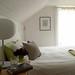 Lovely white bedroom: White beadboard + modern lamp + green + gray accents