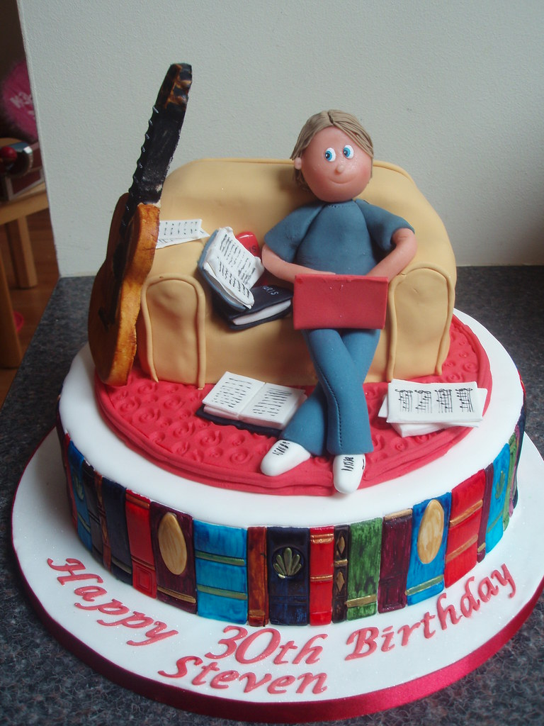 30th Birthday Cake With Books Laptop And Guitar Sitting On