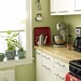 Green kitchen + white cabinets + red accents: 'Sweet Caroline' by Benjamin Moore