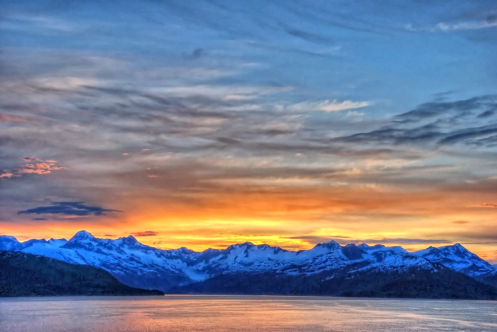 Land of the midnight sun sunset and sunrise over glacier for Free land in alaska