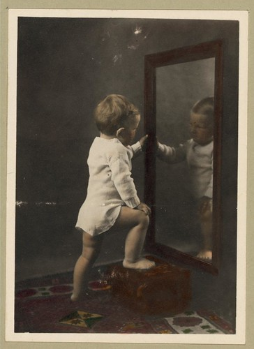 I sure am good looking in my pajamas ... Vintage Picture of a Cute Young Boy Looking at His Reflection in the Mirror | by Beverly & Pack