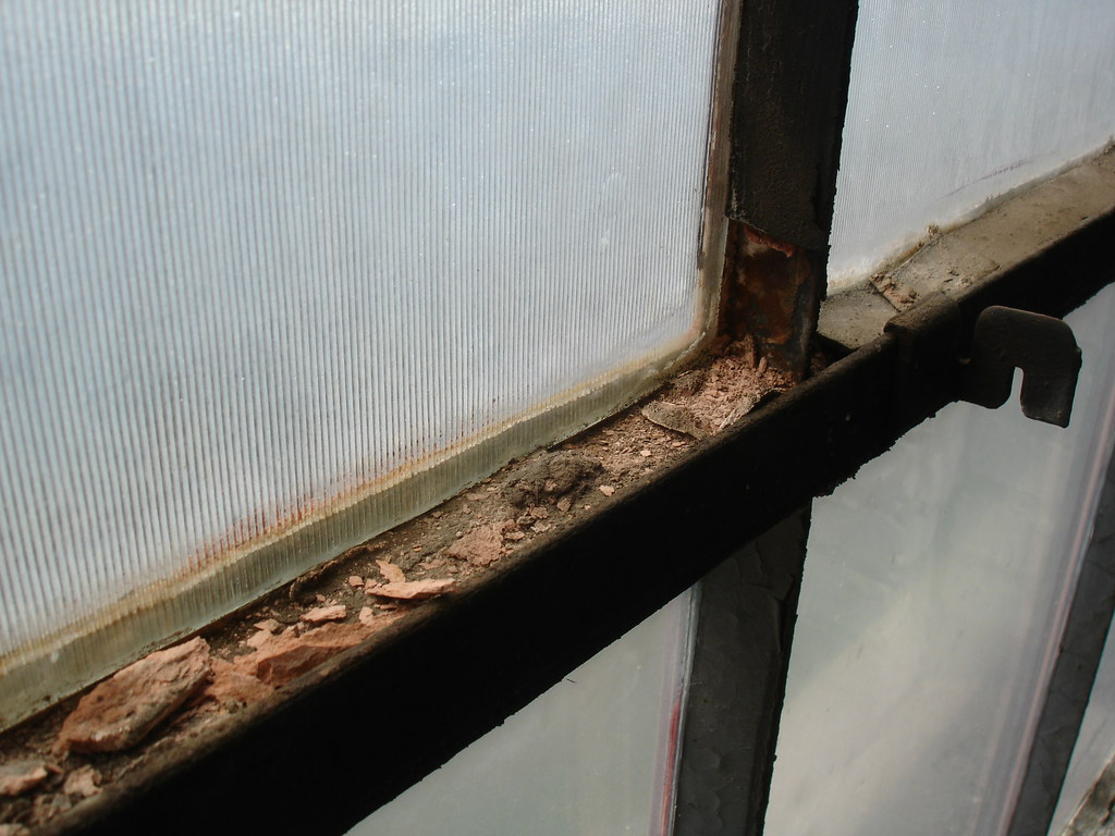 Asbestos window glazing material example of damaged for Window material