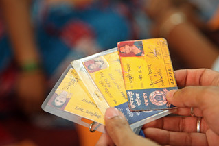 Indentification cards for women in a local finance cooperative | by World Bank Photo Collection
