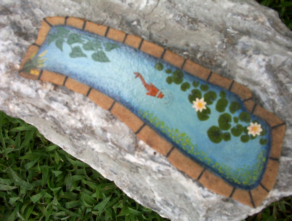 Hand painted rock small koi pond eugenia labar flickr for Fish pond rocks