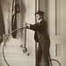 Frances Benjamin Johnston: Self-portrait with false moustache and penny-farthing, ca. 1890