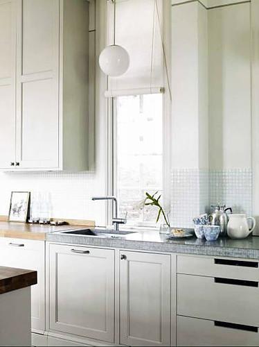 Elegant White Kitchen With Dark Espresso Island