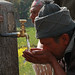 A villager of Kaski shows how well the water tap work