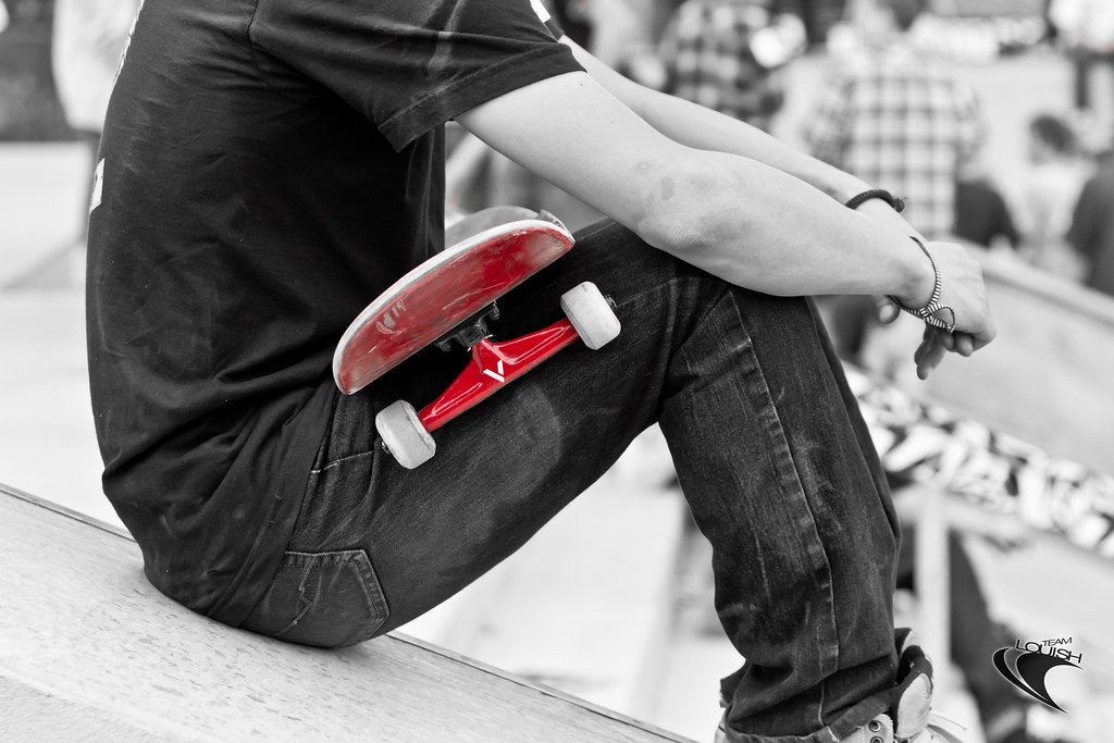 skateboarding black and white with red all over follow