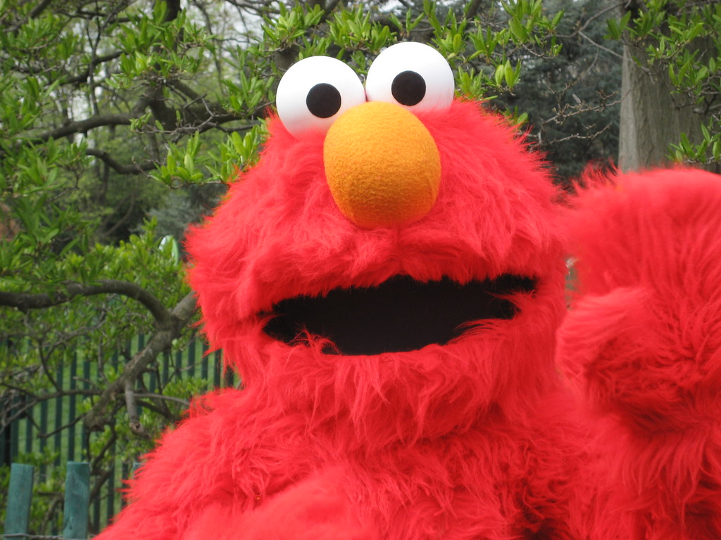 elmo up close looks like he 39 s swatting away the