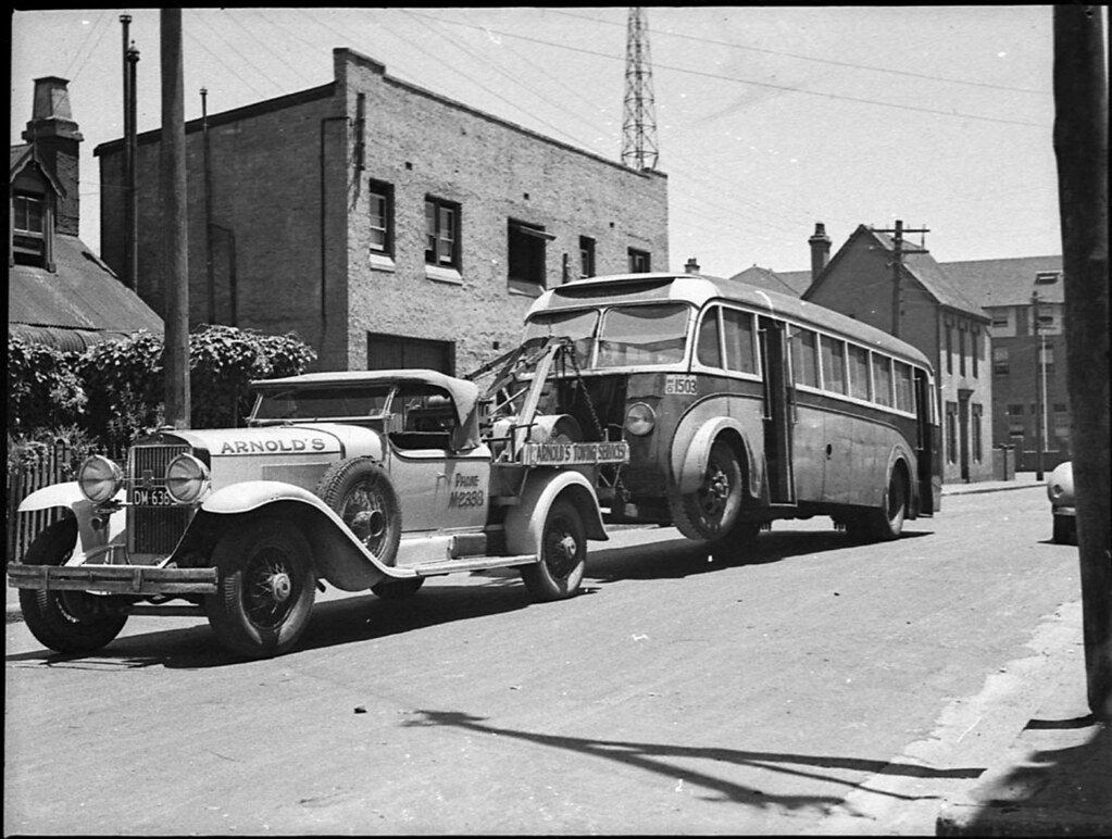 Towed Car Finder >> Motor bus being towed to Queensland, 1929 Cadillac towtruc ...