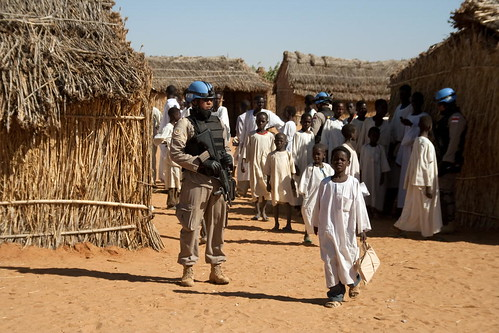 UNAMID Police Officer Patrols IDP Camp | by United Nations Photo