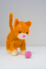 Kitty and yarn ball