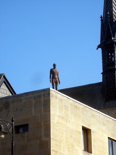 Man-on-roof-sculpture-on-broad-street-roof-i-wonder-if