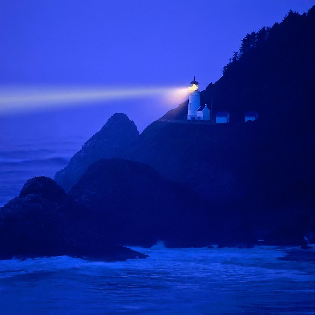 Lighthouse beams across stormy night sea - Heceta Head, Or ...