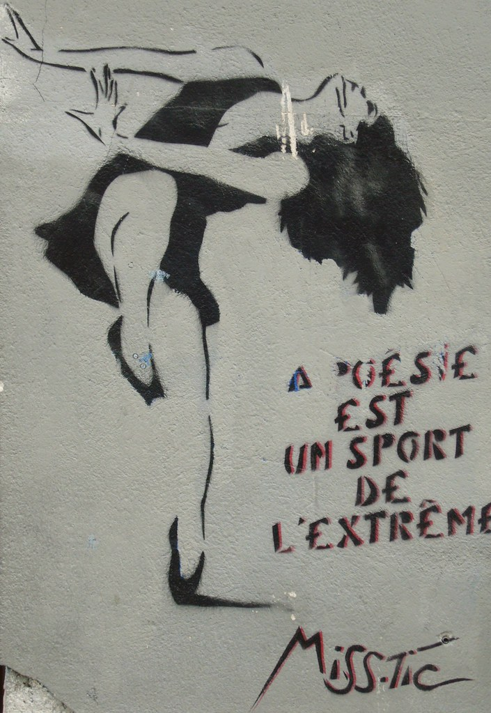 Stencil of a woman in a dress, dancing, head thrown back, hair hanging down, next to the words