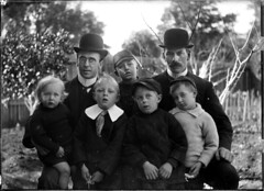 Portrait of two seated men in bowler hats with five children | by Powerhouse Museum Collection