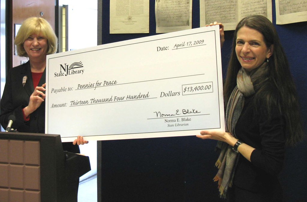 Pennies For Peace Check Presentation In A Ceremony At